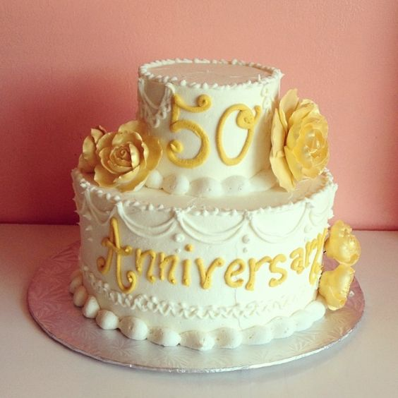 Buttercream anniversary cake with buttercream piping and sugar flowers