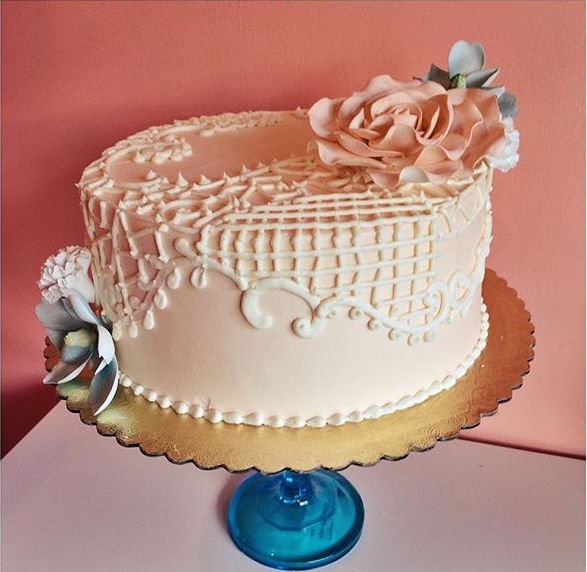 Blush buttercream cake with buttercream lace piping