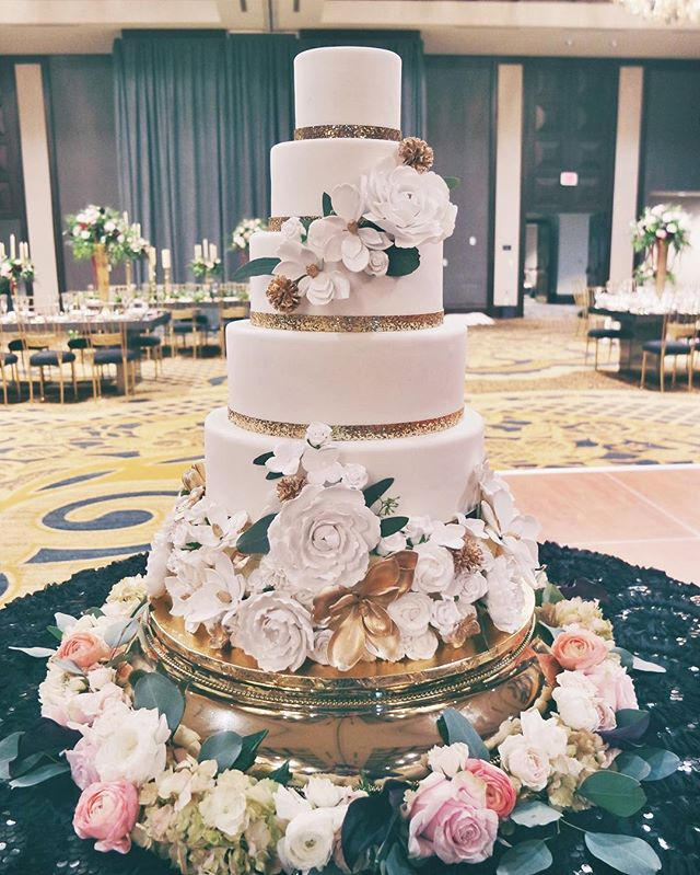 white and gold sugar flower cake