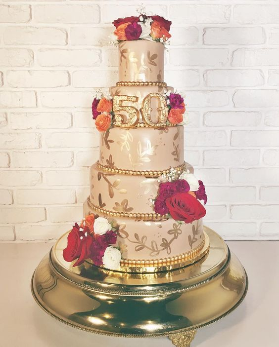 50th anniversary cake with neutral fondant and hand painted  gold  details