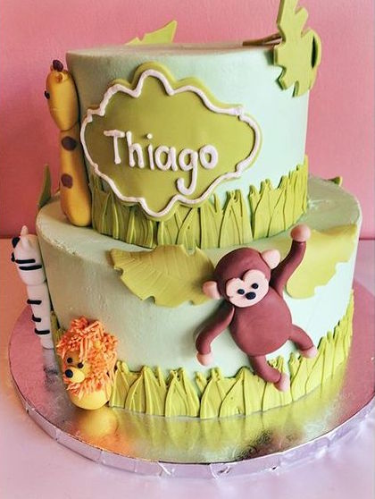 Mixed buttercream and fondant cake with jungle theme