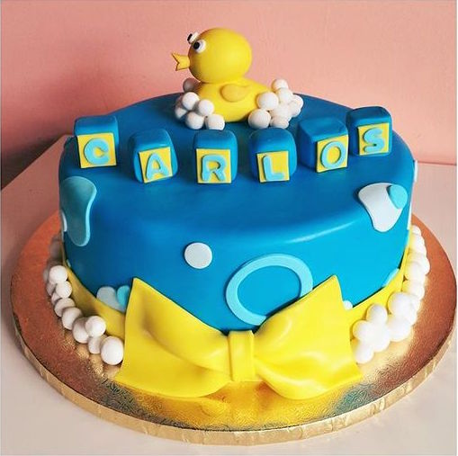 Fondant covered cake with buttercream bubbles and 3D fondant rubber duckie