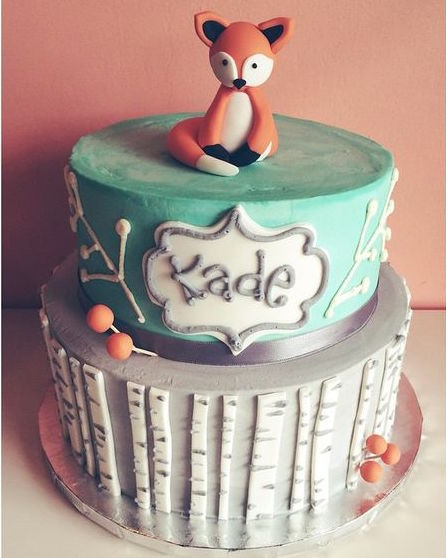 Buttercream based cake with fondant details and 3D fondant fox figurine
